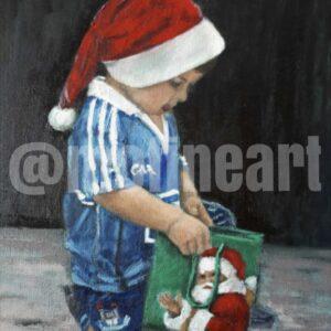 Little boy Dublin GAA jersey Santa Claus hat reaching into a bag