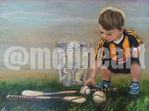 Boy Kilkenny GAA with the Liam McCarthy Cup and a hurl and slitter