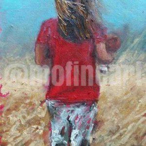 Little girl red tee shirt walking through field of wheat