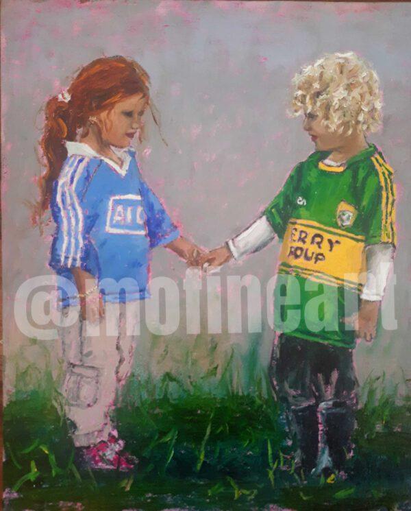 Little boy and girl Kerry and Dublin GAA Jerseys holding hands