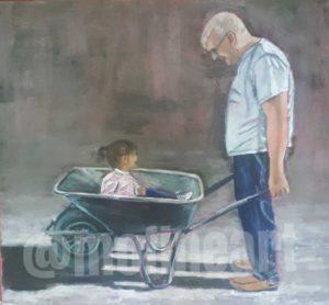 Little girl in wheelbarrow with Grandad sunlight