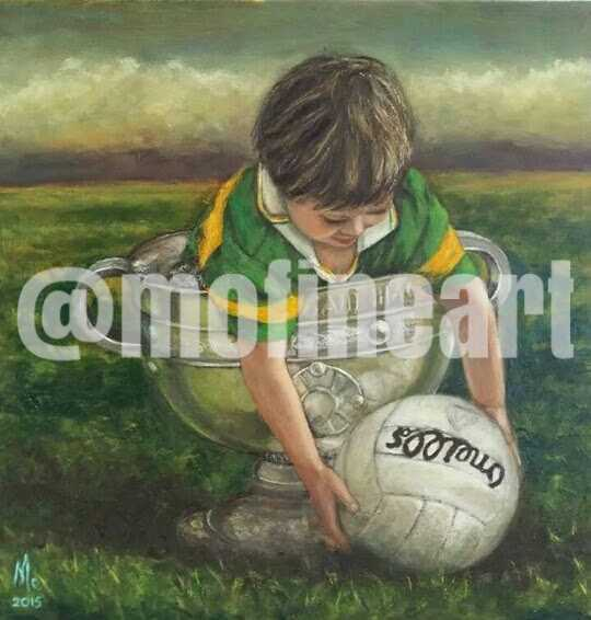 Little boy Kerry Jersey in the Sam Maguire holding a football