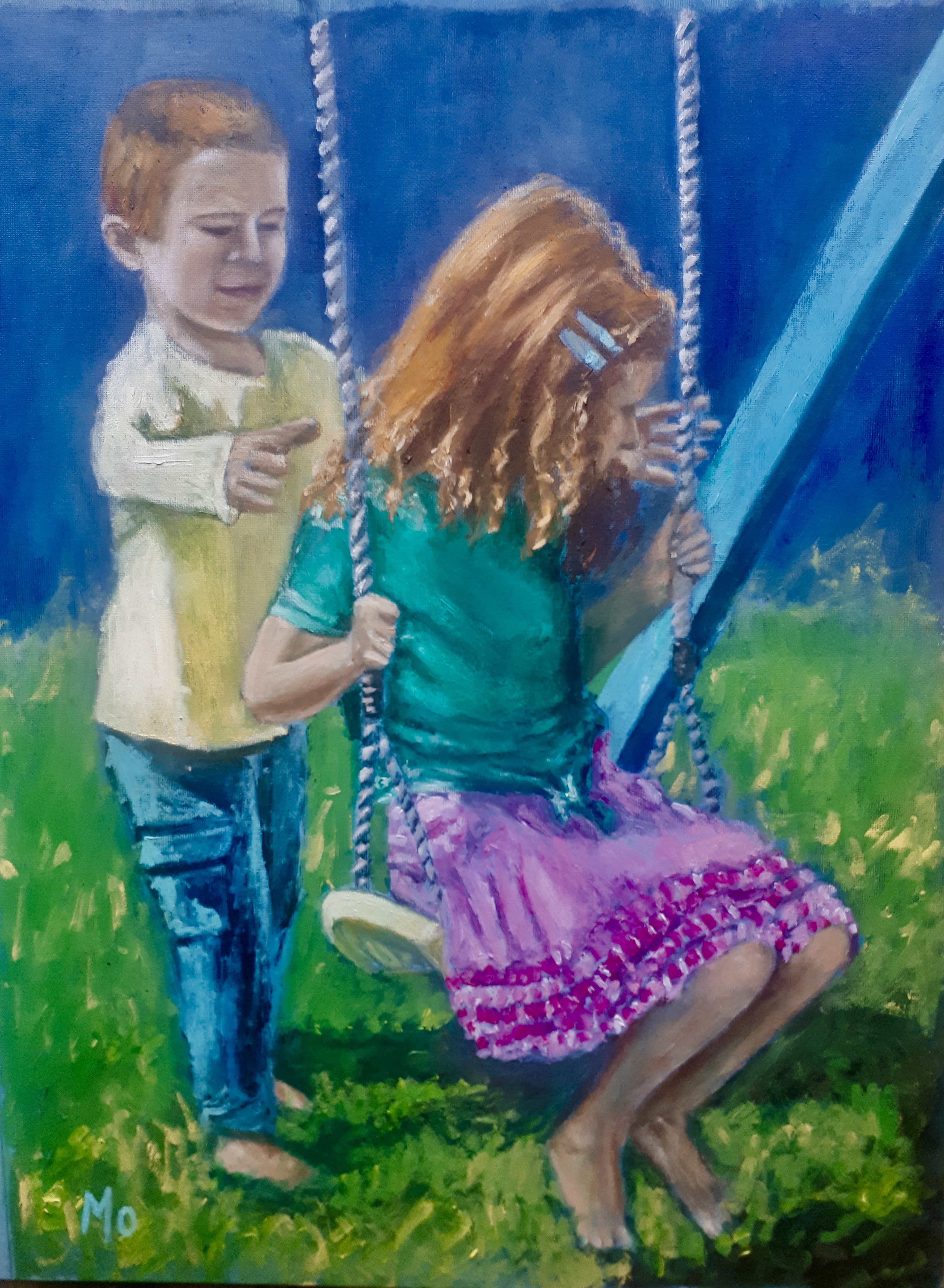 Little redheads playing on a swing
