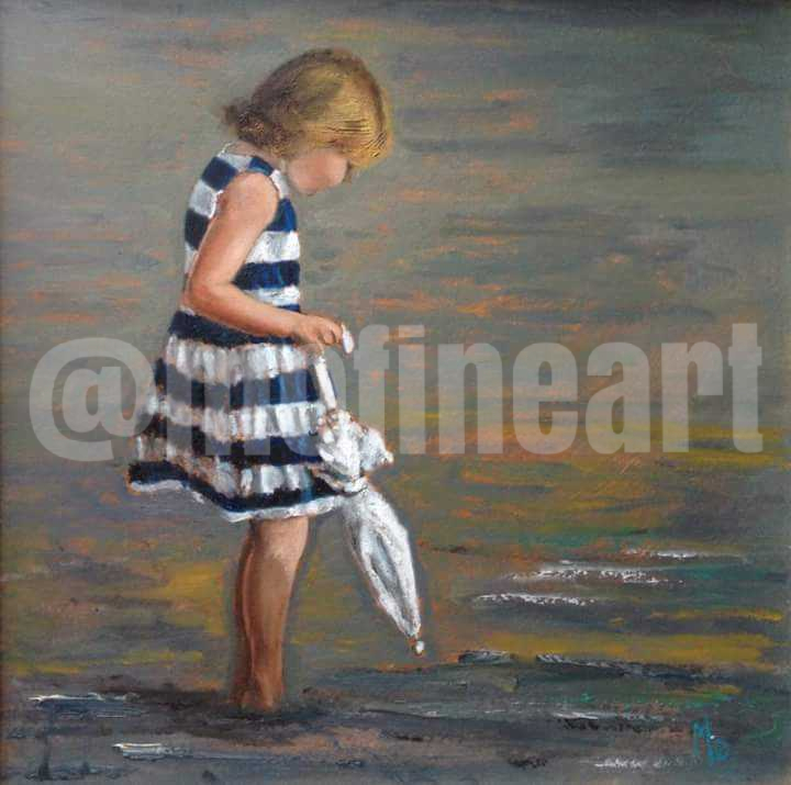 Little girl on the beach blue and white striped dress