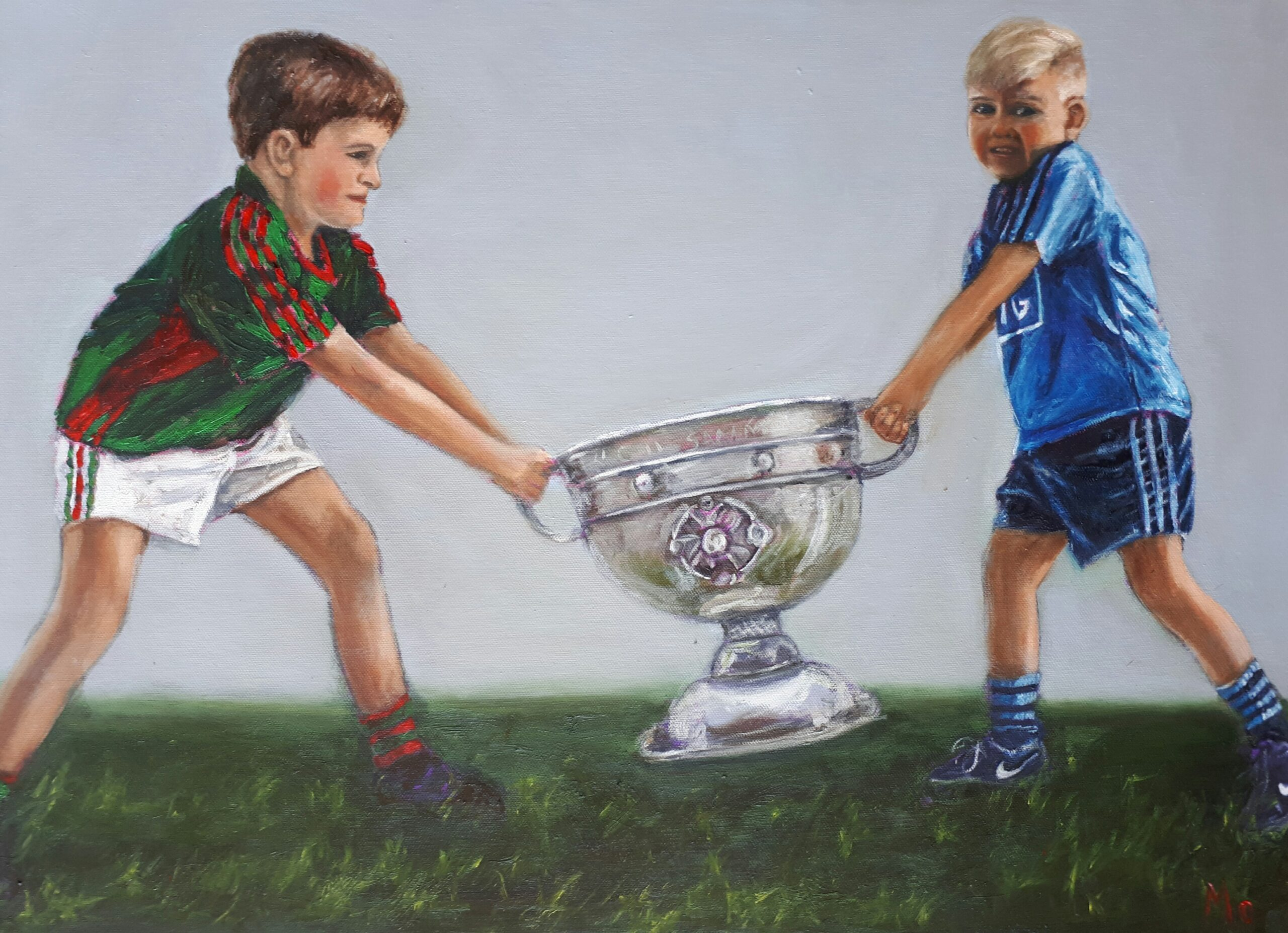 Dublin and Mayo boy fighting over the Sam Maguire
