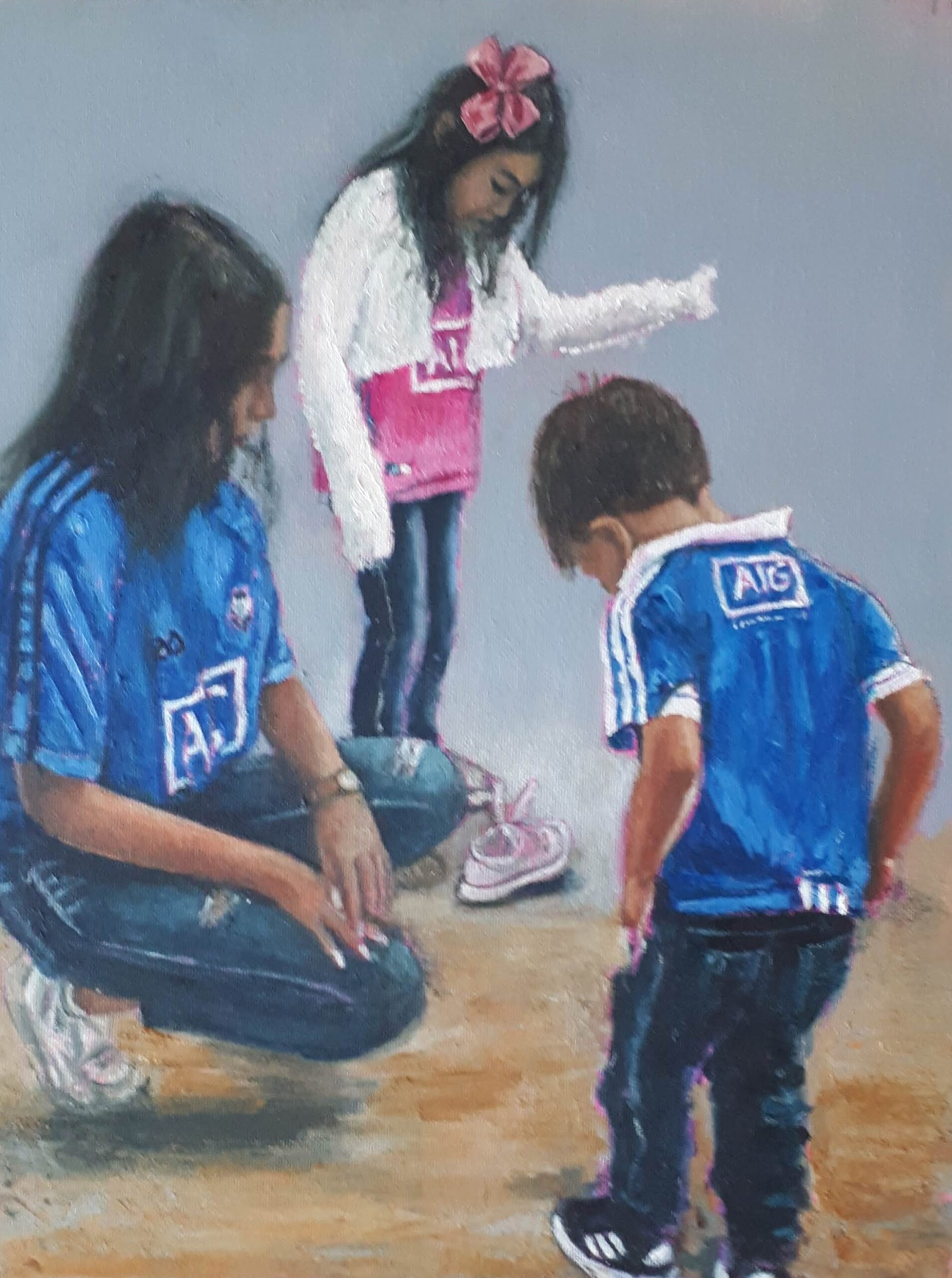 Three children on the beach in Dublin Jerseys