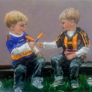 Two boys Tipperary and KILKENNY JERSEYS FIGHTING over ice cream