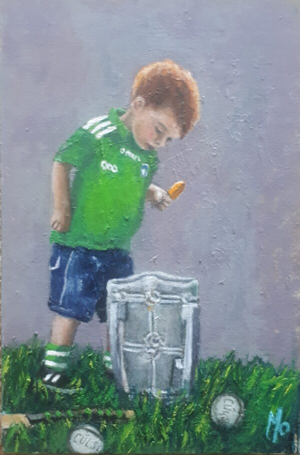 Little boy green jersey looking into McCarthy cup