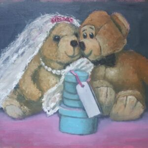 Two teddies dresses as Bride and Groom