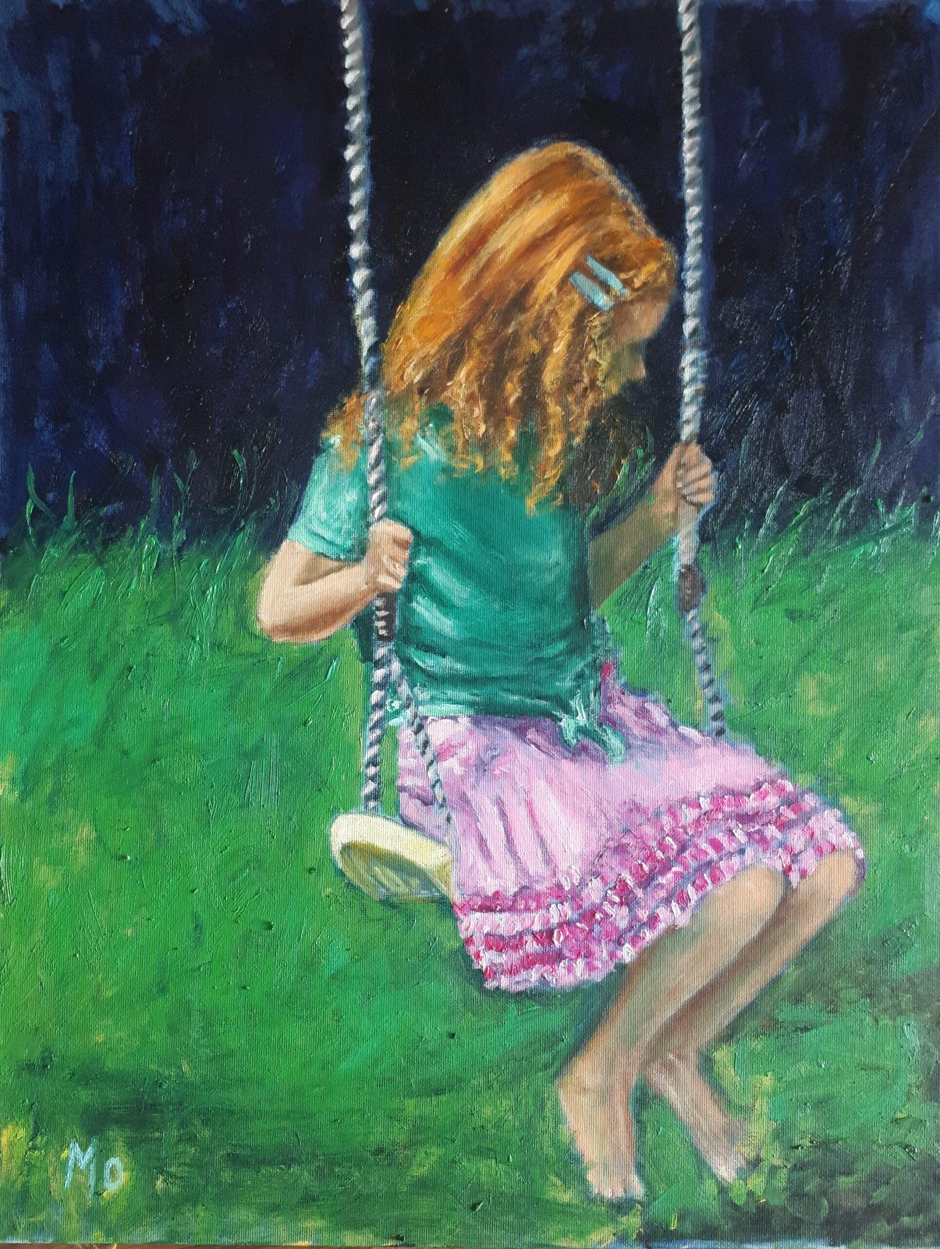 Redheaded girl on a swing