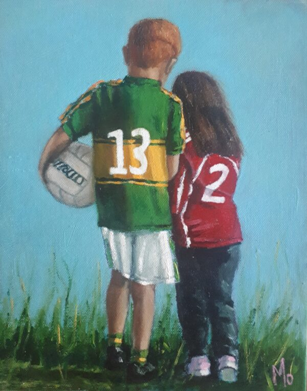 Boy and girl walking with O'Neills football