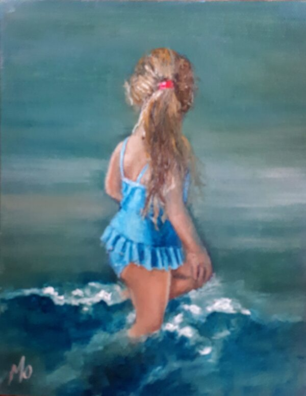 girl with blue dress is sea