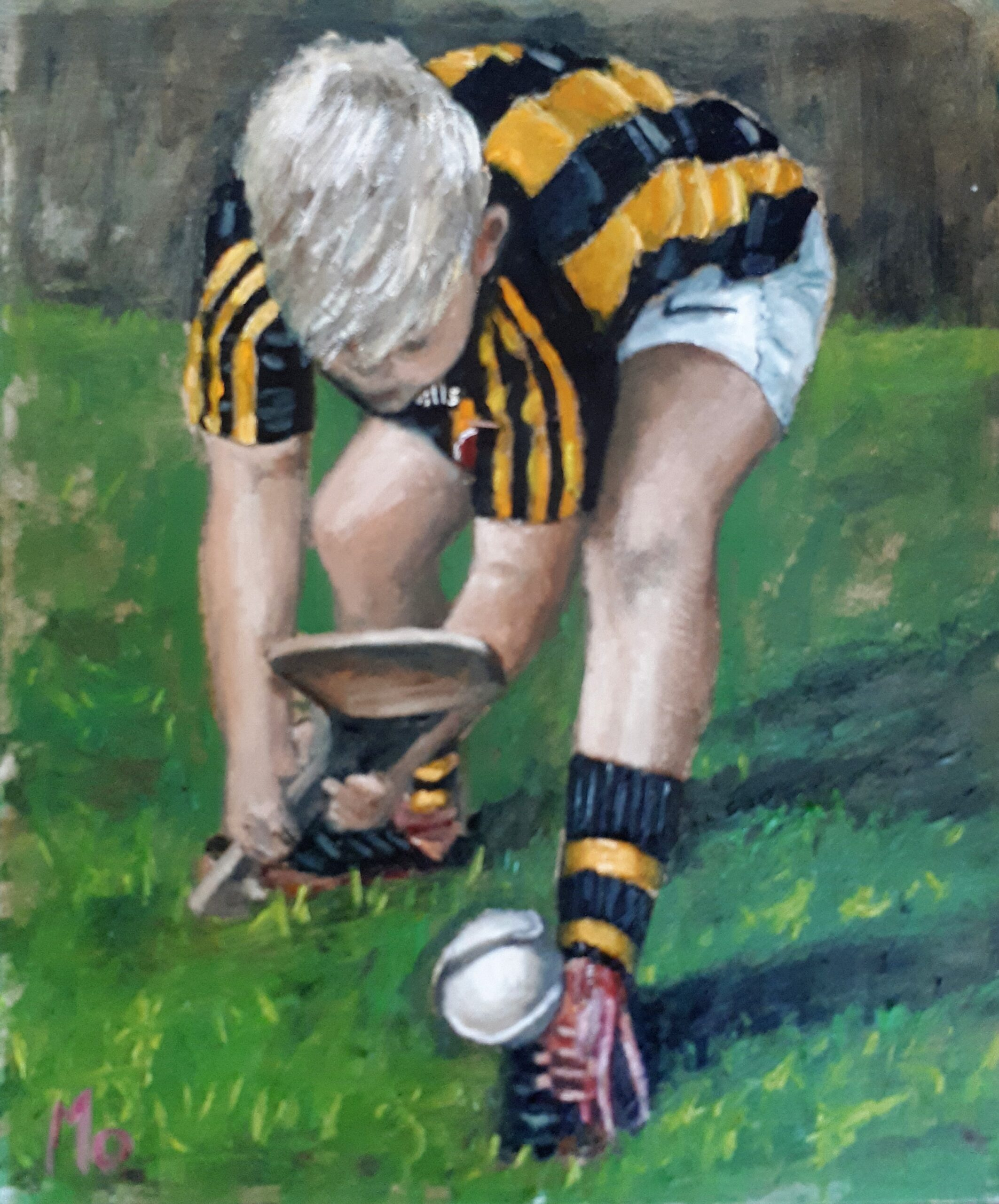 A kilkenny boy with a sliotar and hurley