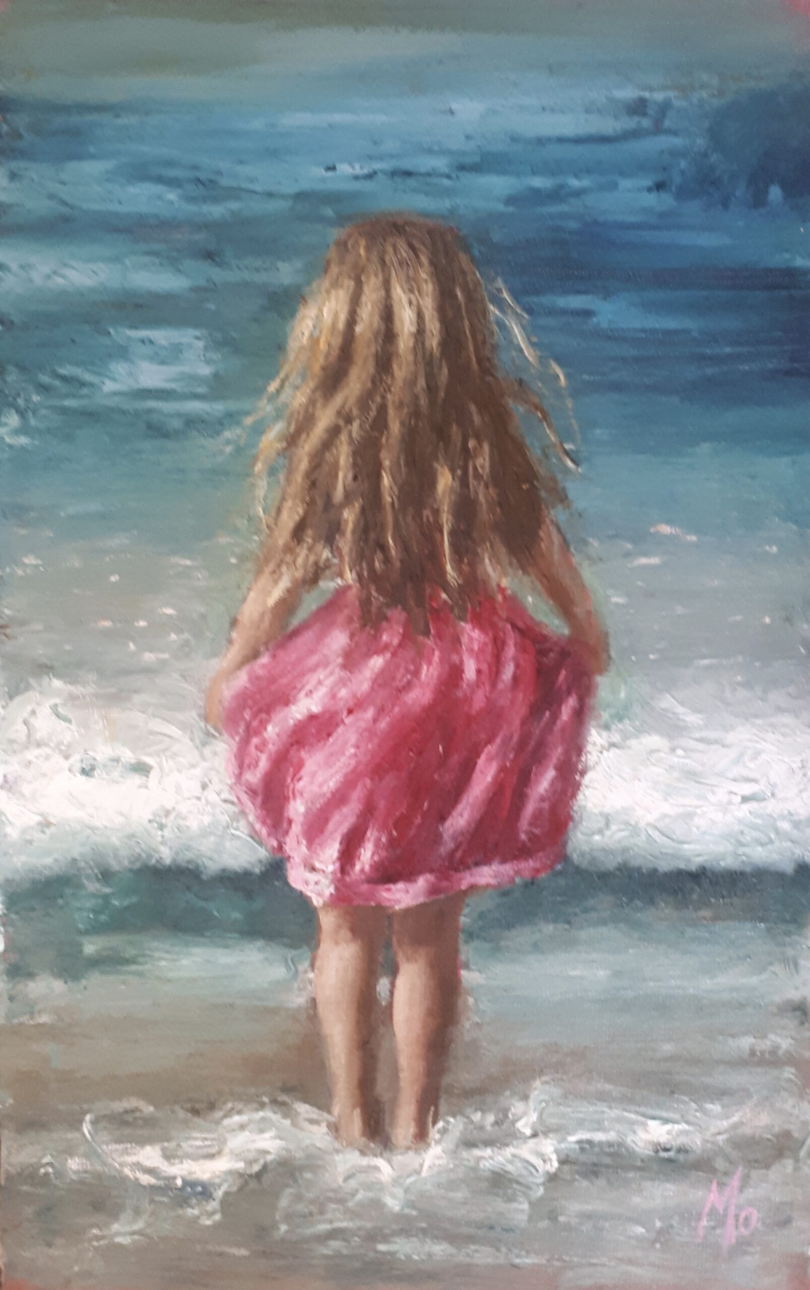 girl in water with pink dress