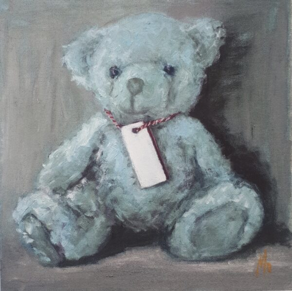 Little Blue Teddy Bear with tag around its neck