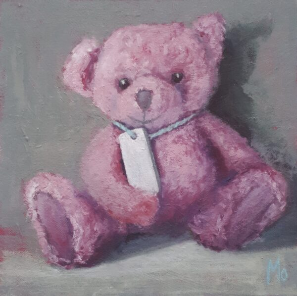 Little Pink Teddybear with a tag around its neck