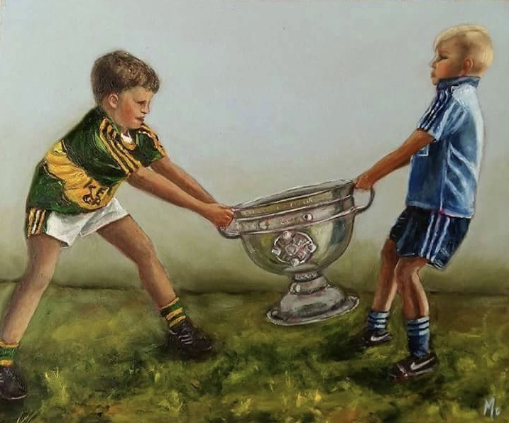 Two boys fighting over Sam Maguire