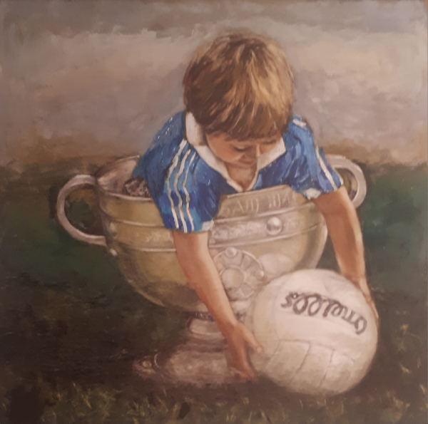 Little boy Dublin jersey the Sam Maguire reaching out to pick un a